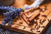 Aromatic cinnamon sticks and lavander close-up, perfect ingredients for a healthy tea — Stock Photo