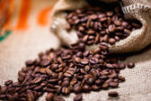 Fresh bio aromatic coffee beans. imported in vintage cloth package — Stock Photo