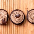 Three chocolate muffins filled with sweet hazelnut cream. view from top — Stock Photo
