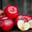 Organic fresh apples on wooden background in autumn harvest at local farm — Stock Photo