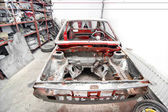 General view of vintage car in restoration process at car workshop — Stock Photo