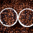 Detail of white cups of coffee filled with coffee beans, aromatic and fresh african coffee — Stock Photo