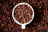 African fresh bio coffee beans with cup, detail view from top — Stock Photo