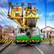 Industrial mobile crane with hydraulic and telescopic rack operating on work construction site  — Stock Photo