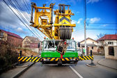 Industrial mobile crane with hydraulic and telescopic rack operating on work construction site — ストック写真