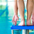 Start swimming race concept with male swimmer in swimming pool — Stock Photo