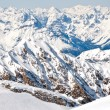 Winter landscape with lopes on a skiing resort in the Alps with mountains background — Stock Photo