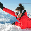 Girl waving from top of european Alps with a huge smile on her face — Stock Photo