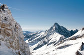 Scenic view from high mountain in Austrian Alps in winter in remote area — Stock Photo