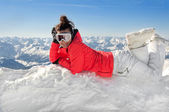 Female skier on top of european alps with mountain background — Stock Photo