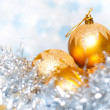 Stock Photo: Christmas tinsel decoration with balls and colorful background