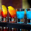 Several alcoholic shots of diferent drinks at a party in a nightclub on the counter — Stock Photo