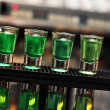 Blue and green drink in shot glasses standing on the counter — Stock Photo #37081939