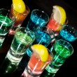 Several shots of different drinks at a party in a nightclub — Stock Photo