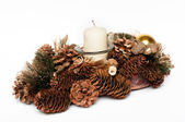 Christmas wreath with candle and cones, isolated on white background — Photo