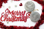 Merry Christmas background with grey snowflake balls and little stars — Stock Photo