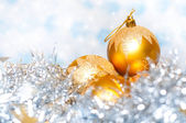 Christmas tinsel decoration with balls and colorful background — Stock Photo