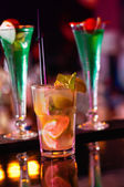 Mojito Drink between Cuba Libre drinks, served in a nightclub — Stock Photo