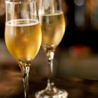 Couple of champagne glasses on bar on new year's eve — Stock Photo #37170171