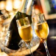 Glasses of champagne for a wedding reception with bottle background — Stock Photo #37170187