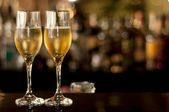 Two glasses of champagne waiting to be served by guests in a restaurant, new year's eve. — Stock Photo
