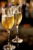 Couple of champagne glasses on bar on new year's eve — Stock Photo