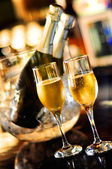 Glasses of champagne for a wedding reception with bottle background — Stock Photo
