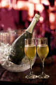 Glasses of champagne for a wedding reception isolated on red background — Stock Photo