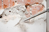 Close-up of jackhammer destroying walls — Stock Photo