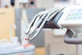 Dental tools on dentist chair with medical equipment and new technology — Stock Photo