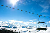 Mountain slopes with chairlift on a winter sunny day — Stock Photo