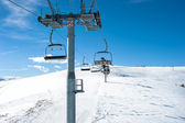 Chairlift on ski slope in mountain resort  — Zdjęcie stockowe
