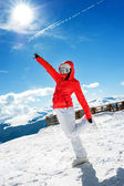 Young skiing girl or woman posing against winter sunny landscape — Foto Stock