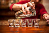 Close-up of bartender hand pouring alcoholic drink in nightclub, — Stock Photo