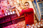Barman using a shake mixer cocktails and drinks in nightclub, bar or pub — Photo