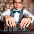 Barman preparing shots for cocktail party on bar — Stock Photo #42274689