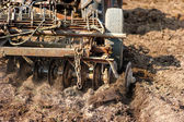 Close-up of agriculture harvesting and cultivating using a plow — Stock Photo