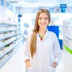 Pharmacist chemist woman standing in pharmacy drugstore — Stock Photo #43945995