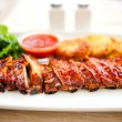 Main dish - pork ribs and barbeque sauce with parsley and bread — Stock Photo #43946085