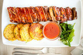 Pork ribs and barbecue sauce at local restaurant — Stock Photo