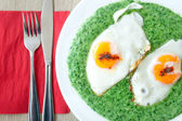 Spinach with spicy eggs at breakfast — Stock Photo