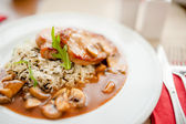 Juicy,  suculent grilled pork chops with mushrooms and rice as main course at restaurant — Stock Photo