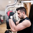 Sporty man doing chest exercise at gym, daily workout routine — Stock Photo