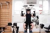 Handsome man working out at gym, daily chest exercise routine. Fitness concept — Stock Photo