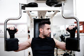 Workout at the gym, chest exercise at bench — Stock Photo