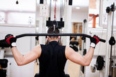 Muscular Man Exercising In Gym - Bodybuilder Doing Heavy Weight Exercise For Back, fitness concept — Foto de Stock