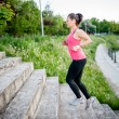 Healthy lifestyle sports woman running on street stairs along river — Stock Photo