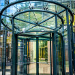 Close-up of modern secured glass door at corporate business building. Revolving door at business center or corporate building — Stock Photo #47912745