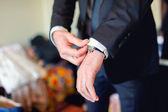 Close up of elegant man, groom hands with suits, ring, necktie and cufflinks on wedding day — Stock Photo