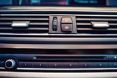 Details and close-up of air conditioning and car ventilation system. Modern car interior with vent holes — Stock Photo